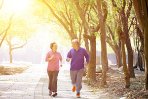 two adults jogging